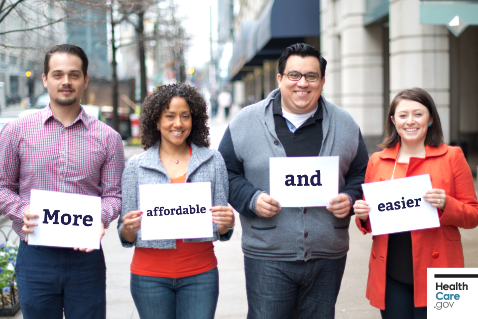 "Image: {Friends stand together holding signs that read ""More affordable and easier""}"