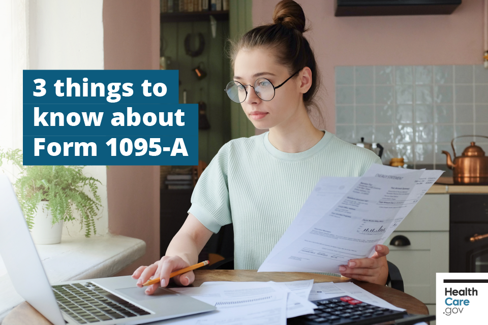 Image: {Woman reviews Form 1095-A to file taxes at computer}