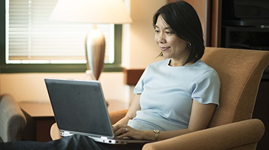 Woman reading fees information online
